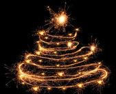 Sparklers in Christmas tree-shaped — Stock Photo
