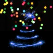 Stock Photo: Sparklers in Christmas tree-shaped