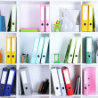 White office shelves with folders and different stationery, close up — Stock Photo #37474143