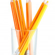Stock Photo: Pencils in glass isolated on white