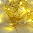 Christmas decorative balls and garland, on wooden background — Stock Photo #37474817