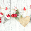 Christmas accessories hanging on white wooden wall — Stock Photo #37476389