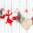 Christmas accessories hanging on white wooden wall — Stock Photo #37476399