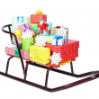 Stock Photo: Sledge with Christmas presents, isolated on white