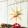 Christmas composition with snowflakes on wooden background — Stock Photo #37476675
