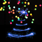Sparklers in Christmas tree-shaped — 图库照片
