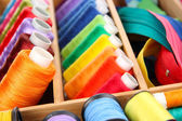 Sewing accessories in wooden box close up — Stock Photo