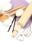 Cooking concept. Basic baking ingredients and kitchen tools isolated on white — Stok fotoğraf