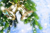 Bells with Christmas decoration on light background — Stock fotografie