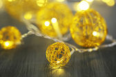 Christmas decorative balls and garland, on wooden background — Stok fotoğraf