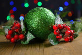 Composition of Christmas decorations on table on bright background — Stock Photo