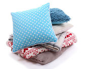Colorful pillows and plaids isolated on white — Stock Photo