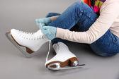 Skater wearing skates on gray background — ストック写真