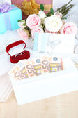 Euro banknotes as gift at wedding on wooden table close-up — Stockfoto