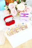 Euro banknotes as gift at wedding on wooden table close-up — Stock Photo