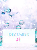 Calendar with New Year decorations on winter background — Stockfoto