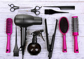 Hairdressing tools on white wooden table close-up — Stock Photo