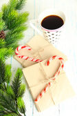 Christmas candy canes, cup with hot drink and letters for Santa, on wooden background — Stockfoto