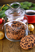 Delicious Christmas cookies in jar on table close-up — ストック写真