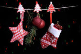 Santa mitten and Christmas accessories on black background with lights — ストック写真