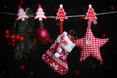 Santa sock and Christmas accessories on black background with lights — ストック写真