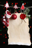 Blank sheet with Christmas decor on black background with lights — ストック写真