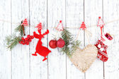 Christmas accessories hanging on white wooden wall — Photo