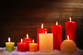 Burning candles on wooden background — Stock Photo