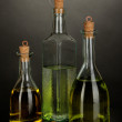 Original glass bottles with oil isolated on black — Stock Photo #37512803