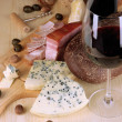 Stock Photo: Exquisite still life of wine, cheese and meat products