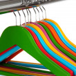 Stock Photo: Colorful clothes hangers isolated on white