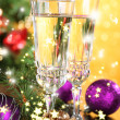 Composition with Christmas decorations and two champagne glasses, on bright background — Stock Photo #37514811