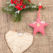 Stock Photo: Decorative heart and star on rope, on burlap background