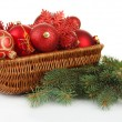 Stock Photo: Christmas decorations in basket and spruce branches isolated on white