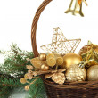 Christmas decorations in basket and spruce branches isolated on white — Stock Photo #37518865
