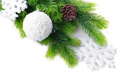 Christmas balls and snowflake on fir tree, isolated on white — Stockfoto