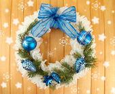 Christmas wreath on wooden background — Stockfoto
