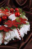 Christmas wreath on fabric background — Stockfoto