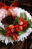 Christmas wreath on fabric background — Стоковое фото