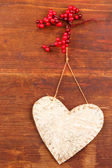 Decorative heart with rope, on wooden background — Stock Photo