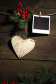 Decorative heart and empty photo paper on rope, on wooden background — Stockfoto