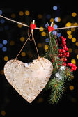 Decorative heart on rope on shiny background — 图库照片