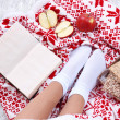 Composition with warm plaid, book, cup of hot drink and female legs, on color carpet background — Stock Photo #37521863
