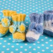 Crocheted booties for baby, on color background — Stock Photo #37527921