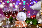 Wine glasses, retro alarm clock and Christmas decoration on bright background — Stockfoto