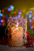 Candle and Christmas tree bud on wooden table on bright background background — 图库照片