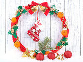 Beautiful Christmas wreath, on wooden background — Zdjęcie stockowe