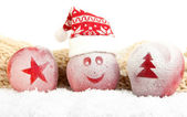 Holiday apples with frosted drawings in snow close up — Fotografia Stock