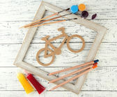 Decorative bicycle with needlework composition on wooden background — Foto de Stock