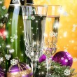Composition with Christmas decorations and two champagne glasses, on bright background — Stock Photo #37556617